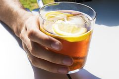 Cup of soda or vermouth. In glass stock image