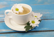 Cup of soothing chamomile tea Stock Photo