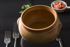 Cup of soup on the dark background prepared for garnish Royalty Free Stock Photography