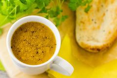 Cup of soup with pepper and naan Royalty Free Stock Images
