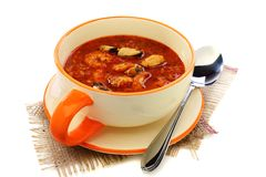 Cup of soup with seafood and tomato. Royalty Free Stock Image