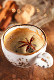 A cup of spiced coffee with anis star and cinamon sticks and sugar stock image