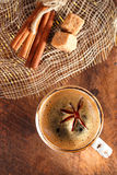 A cup of spiced coffee with anise star Royalty Free Stock Photography