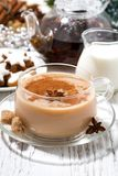 cup of spicy masala tea and Christmas cookies Royalty Free Stock Images