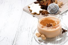 cup of spicy masala tea and Christmas cookies Stock Photography
