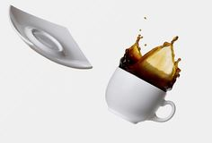 Cup of spilling coffee Stock Photo