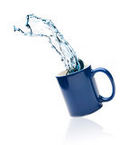 Cup with splashes of water Royalty Free Stock Photos