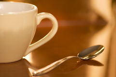 Cup and spoon. Cuo of coffee with spoon Royalty Free Stock Images