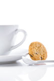 Cup and spoon with cookie  Royalty Free Stock Image