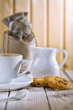 Cup spoon cookies jug bag on white old table Stock Photography