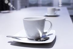 Cup with a spoon in the office Royalty Free Stock Photo