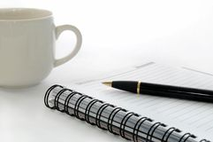 Cup and stationery equipment on white Stock Photos