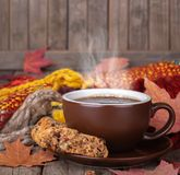 Cup of Steaming Coffee and Cookie on a Rustic Wooden Background stock images