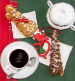 Cup of steaming coffee, croissants and  red vintage decoration. Stock Photo