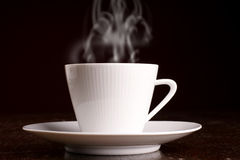 Cup of steaming hot coffee Royalty Free Stock Image