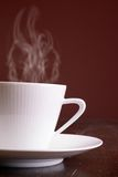 Cup of steaming hot coffee Royalty Free Stock Images