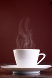 Cup of steaming hot coffee Royalty Free Stock Photos