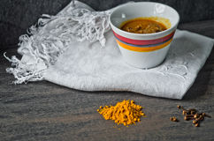 Cup of steaming hot soup with spices on raw cotton embroidered t Royalty Free Stock Image