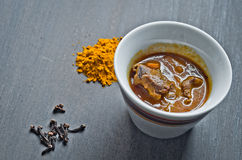 Cup of steaming hot soup with spices Stock Photography