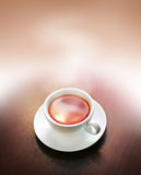 Cup of steaming tea Stock Photography
