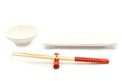 Cup and sticks for a meal Royalty Free Stock Photo