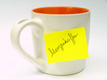 Cup with sticky note  Royalty Free Stock Image