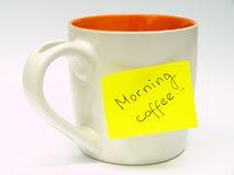 Cup with sticky note Stock Image