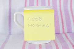 Cup with sticky note Stock Photos