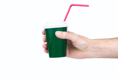 Cup with a straw in his hand Royalty Free Stock Images
