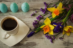 Cup of strong aromatic coffee and beautiful bouquet of spring flowers. Stock Image