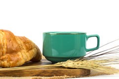 A cup of strong black espresso coffee and fresh croissant Royalty Free Stock Image