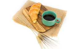 A cup of strong black espresso coffee and fresh croissant isolated Stock Photography