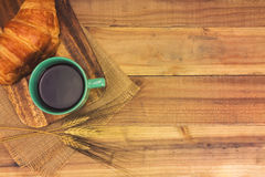 A cup of strong black espresso coffee and fresh croissant Royalty Free Stock Photo