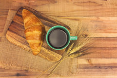A cup of strong black espresso coffee and fresh croissant Stock Photo