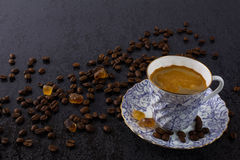 Cup of strong coffee and brown sugar Stock Image