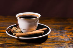 Cup of Strong Dark Coffee with Variety of Spices Royalty Free Stock Photos