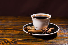 Cup of Strong Dark Coffee with Variety of Spices Royalty Free Stock Photography