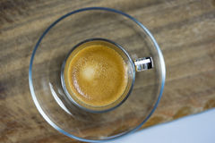 Cup of strong frothy espresso coffee Royalty Free Stock Images