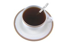 Cup of strong tea with teaspoon Royalty Free Stock Image