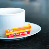 Cup with sugar bag Royalty Free Stock Image