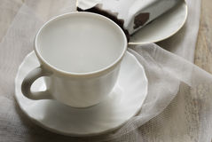 Cup on the table and cake Royalty Free Stock Photography