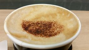 A cup of take away cappuccino coffee Royalty Free Stock Images