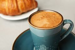 Cup of tasty aromatic coffee for breakfast on grey table royalty free stock images