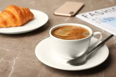 Cup of tasty aromatic coffee and croissant for breakfast royalty free stock photos