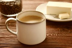 Cup of tasty butter coffee. On wooden table Stock Photo