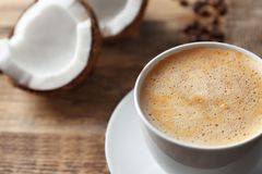 Cup of tasty coconut coffee,. Closeup Stock Photos