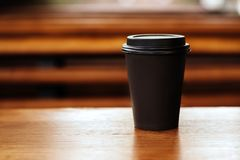 Cup of tasty coffe. Blank paper cup of coffee in a coffee shop for the application logo Royalty Free Stock Photo