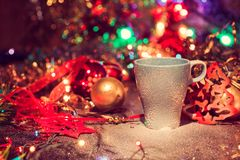 Cup of tasty hot cocoa, on wooden table, with shiny background Royalty Free Stock Image