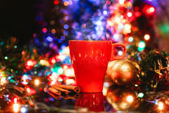 Cup of tasty hot cocoa, on wooden table, with shiny background Royalty Free Stock Photos