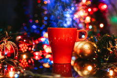 Cup of tasty hot cocoa, on wooden table, with shiny background Royalty Free Stock Images